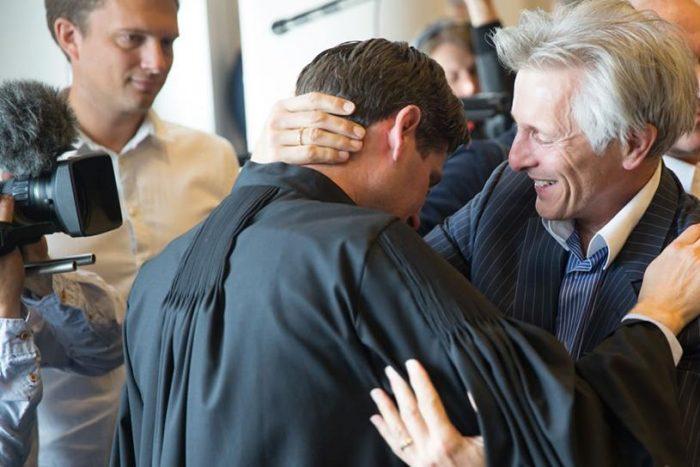 Urgenda Attorney Roger Cox, left, celebrating the verdict with co-plaintiff Maurits Groen. Photo credit: Urgenda / Chantal Bekker